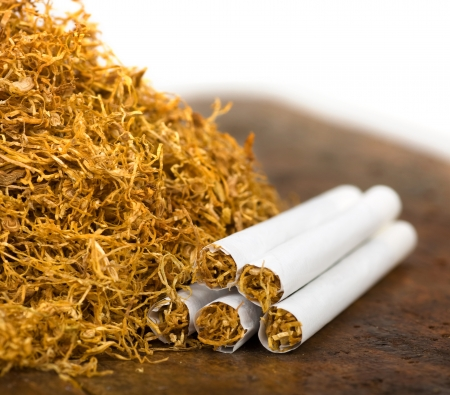 pile of tobacco and hand-rolled cigarettes Stock fotó
