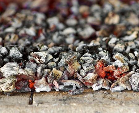 Burning coal in fireplace close up Standard-Bild