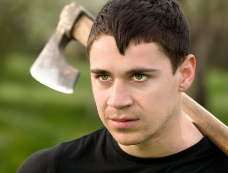 ax man: portrait of a young man with an ax on his shoulder
