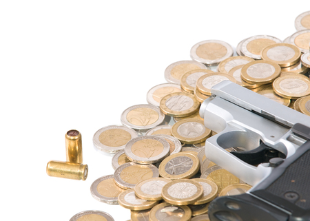 euro coins with a gun and bullets on a white background