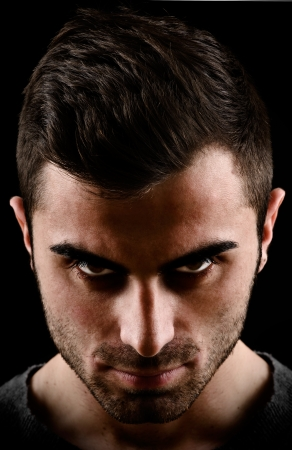 dark portrait of a man with scary eyes Stock Photo