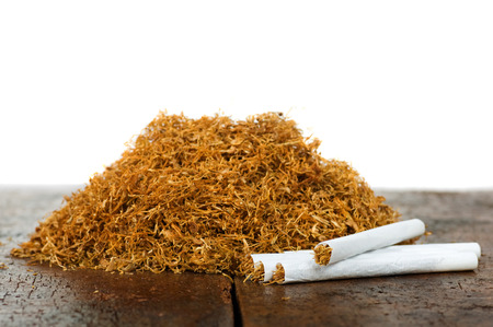 pile of tobacco and hand-rolled cigarettes Standard-Bild