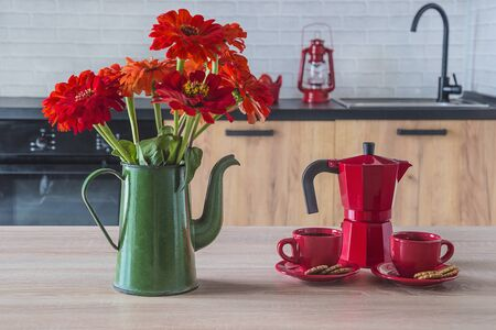 Coffee break and red zinnia bouquet