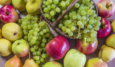 Apples and grapes background