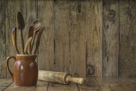 Old wooden utensil on the wooden background Banque d'images