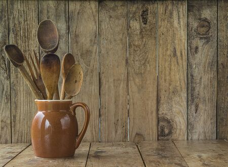 Old wooden utensils on the rustic background Banque d'images