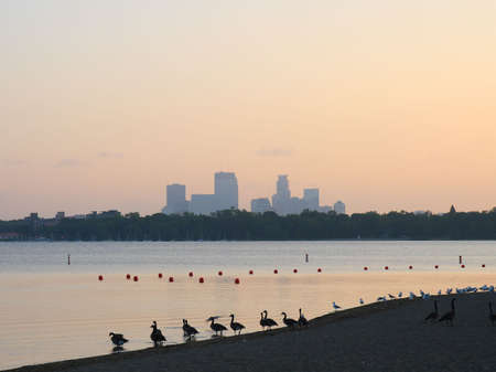 mn: sunrise on lake calhoun, minneapolis,minnesota