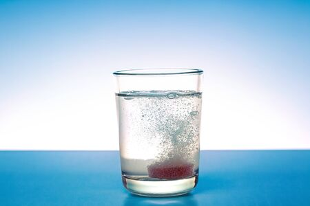 Tablet dissolves in a glass with fresh water 版權商用圖片