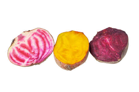 Mix of yellow and Chioggia beets on white background