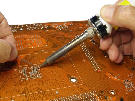 soldering small component on printed circuit board photo