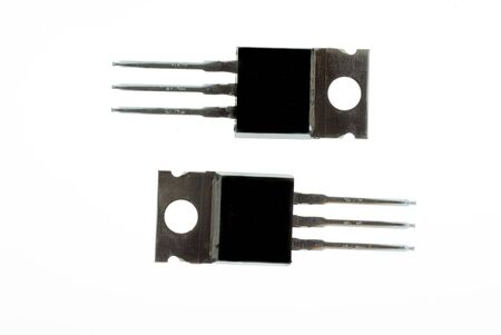 enlarged: Pair of black power transistors isolated on white