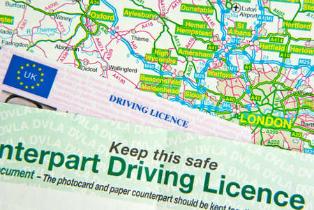 licence: UK driving licence on UK road map around London Stock Photo