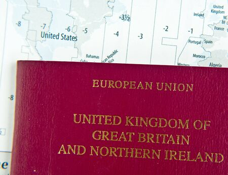 time zones: UK passport on world map with time zones Stock Photo