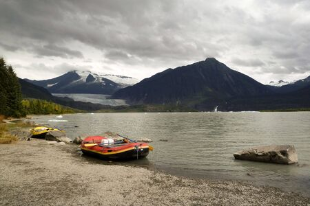 glasier: Alaskan lake view with floating ice and inflateable boat