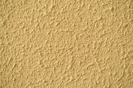 stippled: Stippled wall finish, with bumps and blobs,  in beige Stock Photo