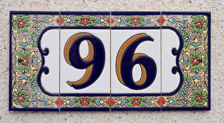 spanish style: House number Spanish style made up from ceramic tiles Stock Photo