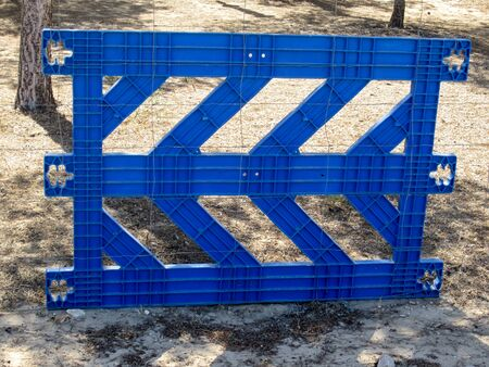fence panel: blue fence panel Stock Photo