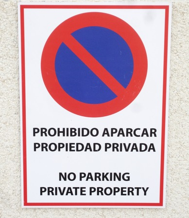banned: No Parking sign