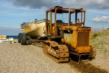 Old Rusty tractor on beach Editorial