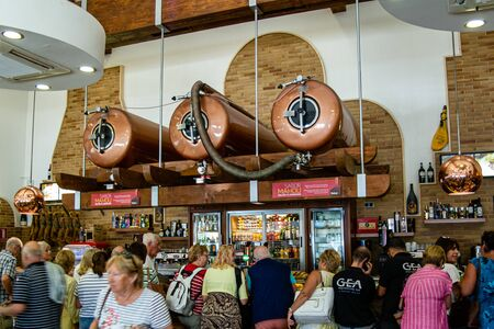 Valenciana, Spain - Oct 17 2019 : View of pressurised beer tanks high up above bar in roadside cafe stop. Sajtókép