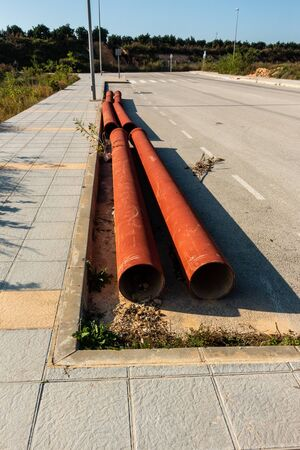 pipes at roadside ready to be laid on spanish urbanisation