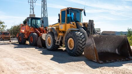 Torrevieja, Valenciana, Spain - Feb 26 2020 : heavy weight diggers parked in spanish urbanisation Éditoriale