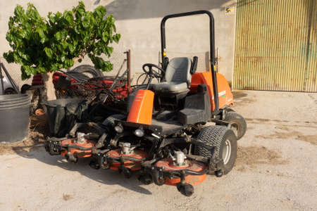 Torrevieja, Valenciana, Spain - May 04 2020 : ride on lawnmower on urbanisation in spain Редакционное