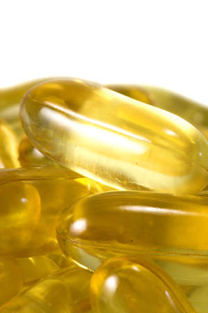 Close up background of oil capsules against white background photo