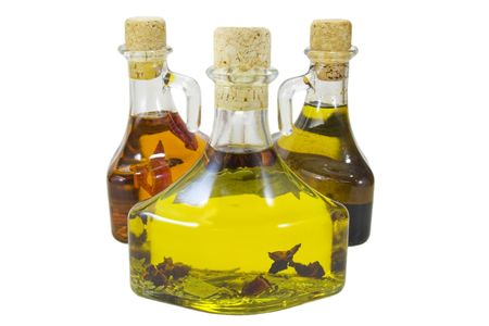 hoja de olivo: Tres botellas de aceite de oliva aisladas sobre un fondo blanco  Foto de archivo