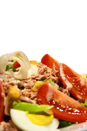 Fresh tuna salad set against a white background photo
