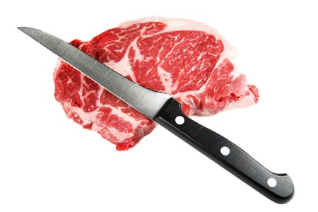 raw beef: Whole raw beef steak and knife isolated against white