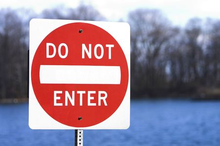 Do not enter sign in front of a body of water and woods Stock Photo - 1209441