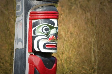 A Native American totem pole close up photo