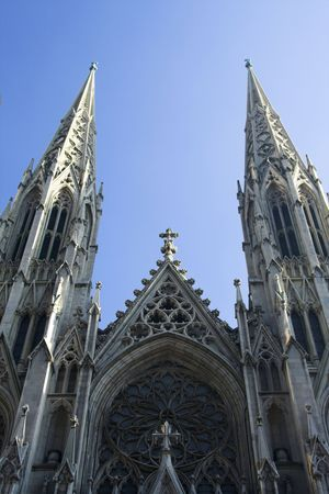 spires: Looking up at cathedral spires set against a blue sky Stock Photo
