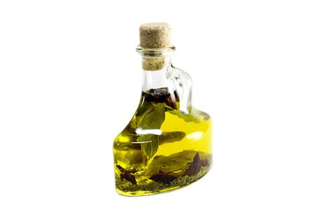 contained: Bay leaves in olive oil contained in a glass bottle