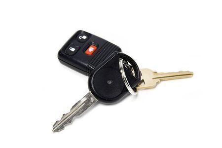 Car keys and car alarm isolated against white photo