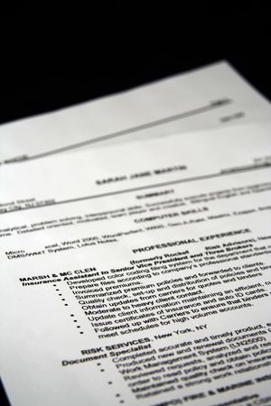 A fictitious resume with a black background photo