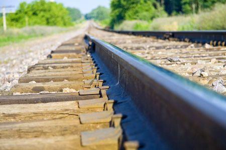 fading: Train tracks fading towards the horizon Stock Photo