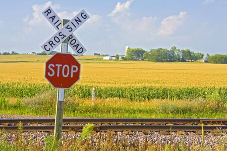 Railroad crossing sign in front of farmland Stock Photo - 1351733