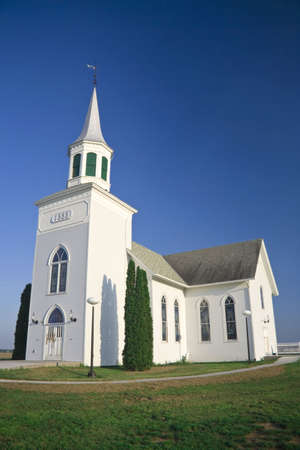 house of prayer: Old white church set against a dark blue sky