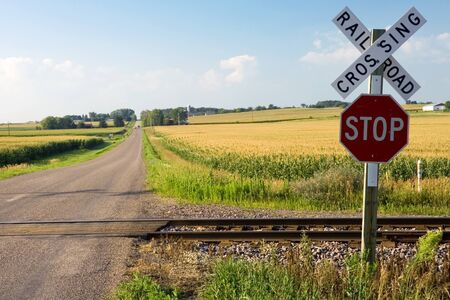 Roalroad crossing and stop sign in farmland