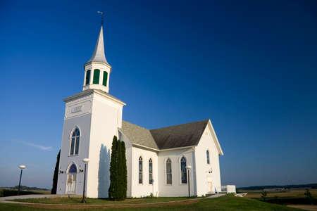 house of worship: Old white church set against a dark blue sky