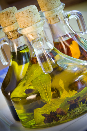 balsamic: Close up of three olive oil and balsamic vinegar bottles Stock Photo