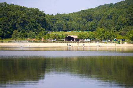 lake beach: Lake beach scenic with woodland reflections