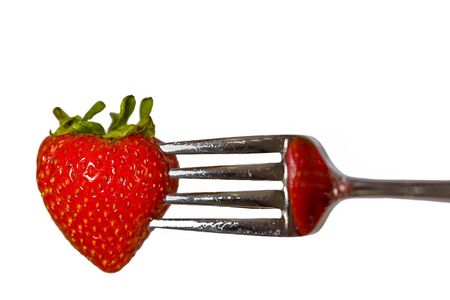 Strawberry on a fork isolated on white