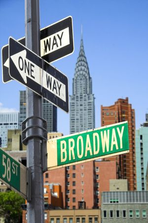 manhattan mirror new york: Broadway sign in front of New York City skyline Stock Photo