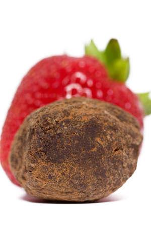 chocolate truffle: Strawberry and chocolate truffle on a white background