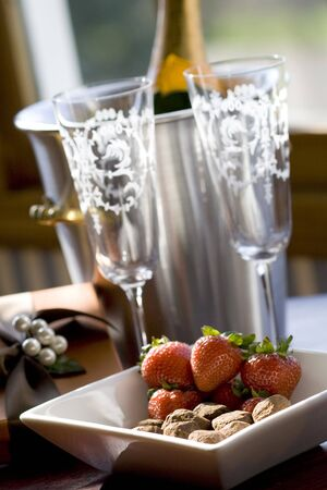 Champagne in a bucket with strawberries and chocolates