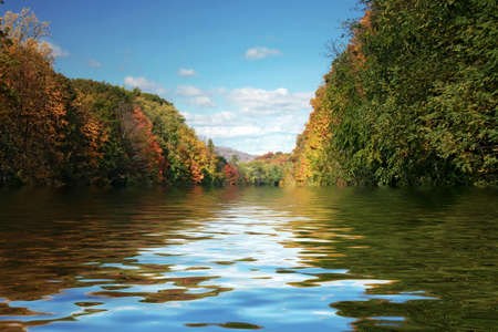 Lake fading into distance with autumn trees Stock Photo - 2515680