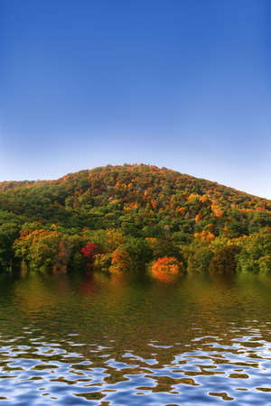 Scenic wooded hill and lake in the fall Stock Photo - 2515679